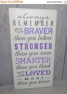 This is a solid wood sign that measures 9 1/2 X 18 X 3/4.    The sign reads:  Always remember you are BRAVER than you believe, STRONGER than you seem, SMARTER than you seem, and LOVED more than you know   The sign shown has been painted WARM WHITE. The letters have been stenciled with LILAC and PEWTER GREY. I have sanded the sides and edges for a distressed look.  **I dont have the color NAVY on my color chart but it is available and I will be adding it!  It has been sealed with 2 coats of…