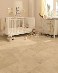 Gorgeous Yorkstone vinyl sheet flooring in this babies nursery, giving a stone effect whilst being  soft and warm underfoot, and easy to clean.