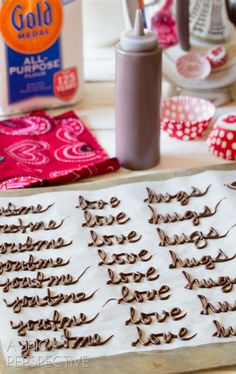 Lovey-dovey Chocolate Words  -Melt chocolate and pour into a squirt bottle or piping bag with a small tip. Then lay wax paper out on your counter top and write connected words like: Love, Hugs, Kisses, Smooch, Hubba Hubba, You+Me, Swoon, Cutie, and so on.Make sure to write more words than needed, because some will break when you pick them up.  Once the chocolate hardens, peel the wax paper off the back and place them on top of the Chocolate Cupcake Recipe with Red Velvet Frosting.