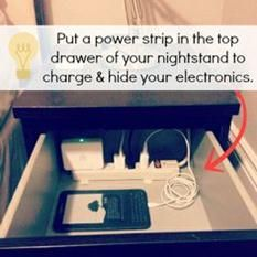 Put a power strip in the top drawer of your nightstand to charge and hide your electronics.   Check out more ways to organize your apartment room by room!