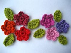 This is a very simple little tutorial pattern for small five-petalled flowers and leaves. They can be used to embellish all sorts of crochet, knit or fabric. (Note: UK crochet terms)