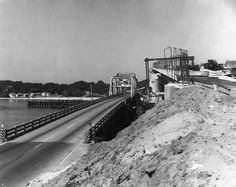 "The cutline that appeared with this Nov. 2, 1965, Daily News photo reads, ""This 1965 photo shows the old bridge connecting downtown Fort Walton Beach with Okaloosa Island. Towering over the old two-lane drawbridge is Brook's Bridge, still under construction."""
