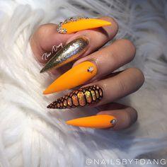 Neon Orange stiletto nails