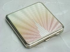 A stunning, British sterling silver and guilloche enamel women's compact in fine Art Deco style, made by J. Gloster Ltd., in Birmingham in 1921