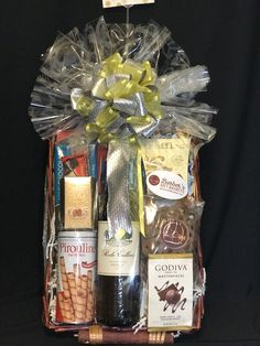 Assortment of chocolate items and/or chocolate covered items with bottle of wine.