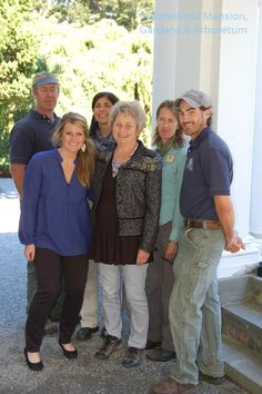 Helen Dillon smiling gamely with Blithewold's horticulture staff - photo by Layanee DeMerchant