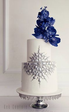 Elegant two tier blue flower topped wedding cake; Featured Cake: Kek Couture