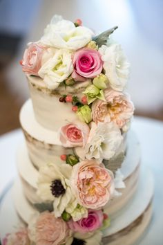 Naked cake with the prettiest floral sash: http://www.stylemepretty.com/australia-weddings/new-south-wales-au/2016/06/07/a-traditional-garden-wedding-gets-a-glam-whimsical-update/ | Photography: Evoke Photography - http://www.evokephotography.com.au/