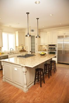 84 custom kitchen island designs. Luxurious beige tone island features wide overhang for dining, with built in range.
