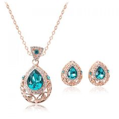 "Pretty Blue Ice Water Drop Set Lovely Necklace & Earrings Set, featuring pretty blue stones in a rose gold tone setting. These are great to dress up an outfit! 3 cm earring length, & 9"" necklace drop. No trades or PayPal. Price is firm. Southern Charm Jewelry"