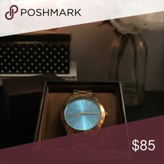 Michael Kors Gold Watch with Teal Face Slim Runway Mother of Pearl Watch. Gently used, no scratches or markings. Sized for a small wrist but original links come with deal. Face is 42mm. Comes in original box and tags included. Michael Kors Accessories Watches