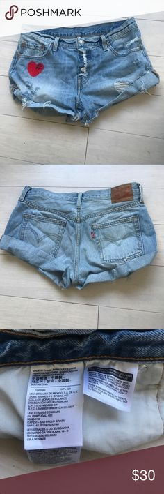 "❤️Levi Strauss shorts sz 28 hearts blue denim ❤️ ❤️Levi Strauss shorts sz 28 hearts blue denim ❤️  ❤️M A T E R I A L : 100% shrink-to-fit cotton❤️  ❤️W A S H : medium-light wash ❤️ ❤️C O N D I T I O N : good worn & weathered condition ❤️ ❤️C O U N T R Y   O F   O R I G I N : china❤️ ❤️T A G G E D   S I Z E : waist 28❤️ ❤️A D D I T I O N A L   D E T A I L S : ❤️ Four button front fly - ❤️2"" Junkyard Jeans chain-stitched black hashtag red heart on front of right leg ❤️ - ❤️Coachella 2018…"