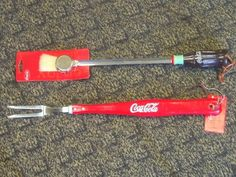 """COCA COLA BBQ BRUSH & FORK SET . $6.98. Bright red Coca Cola BBQ tools; Fork & Brush; 20"""" long with lanyard. Fabulous Coke red handled barbecue tools made of hardwood and steel for years of enjoyment! The indoor or outdoor chef will love this two piece set including a BBQ brush and fork."""