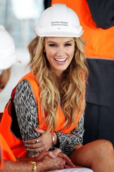 Delta Goodrem, great hair, and probably the most beautiful person you'll see in a hard hat this year :)