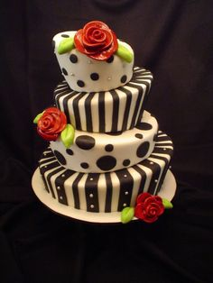 Elegant Topsy Turvy Cake | Whimsical gum paste roses and leaves combined with a simple black and ...