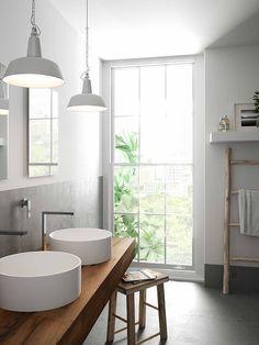 Encimera de madera con lavabos circulares