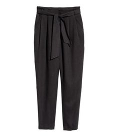 Black. Pants in Tencel® lyocell with a tie belt, pleats at front, and a high waist. Side pockets, mock back pocket, and concealed side zip. Tapered legs.