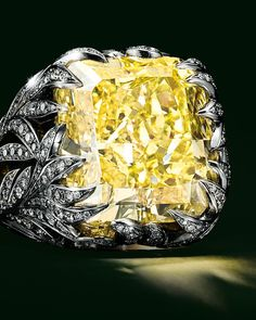Ring in platinum and 18k gold with a rectangular modified brilliant fancy vivid yellow diamond of over 26 carats and white diamonds.