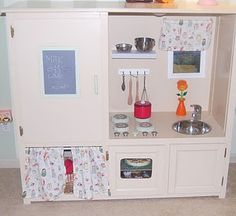 old entertainment center turned awesome play kitchen.