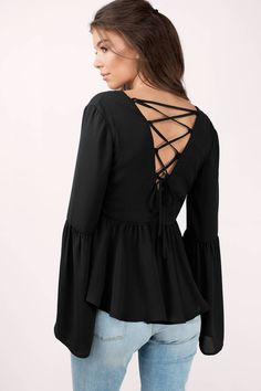 You won't forget the Kalista Lace Up Blouse. Featuring bell sleeves and back lace up detail. Pair with a skirt and heels.