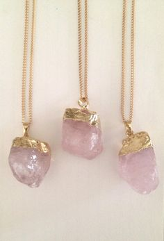 """Unique raw rose quartz, stone of infinite love, is trimmed in gold and set on a 26"""" gold finished cable chin with a lobster claw clasp. Stone: Natural"""