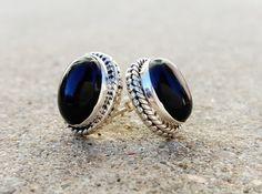 Sterling silver stud earrings with black onyx gemstones.