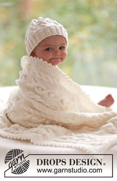 Cables and Cuddles - Bonnet et Couverture avec torsades en DROPSMerino Extra fine. Du 1 mois au 3/4 ans. Modèle tricot layette gratuit  DROPS Baby 17-28