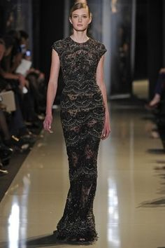 Elle Saab Spring 2013. Beaded dress suggests inspiration from an egyptian bead net dress with close to the body fit, and beading from shoulder to floor.