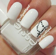 Cross nails. So cute! I wonder what the cross would look like in silver.
