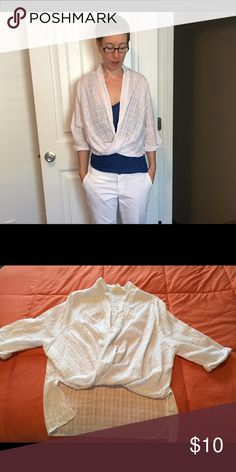 WEEKEND SALE! White cotton hi-lo wrap front blouse Lightweight white top perfect over a tank or layering over long sleeved shirts. It has 3/4-sleeves rolled at the end, a hi-lo style, a wrap front, and a nice pattern to give the fabric an interesting texture. Fits small-medium. Tops Blouses