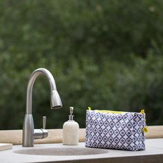 Eyelet toiletry bag - Graymarket Design