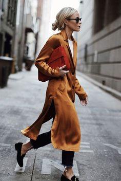 saffron tunic & orange clutch. △@BIBIJOUX