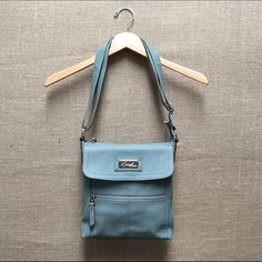 """Kim Rogers Soft Blue Crossbody Bag {NWOT} Brand new/unused. Great size at 9""""w x 2""""d x 10""""h, soft polyurethane material with silver hardware and lots of pockets (interior: 2 open, 1 zipper, exterior: 2 zipper and one snap flap closure. Back zipper pocket has card & ID slots). Adjustable crossbody strap. Light tan lined interior. Kim Rogers Bags Crossbody Bags"""