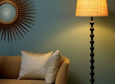 A living room with lamp light featuring Benjamin Moore's   Greyhound (1579) wall paint. For kitchen and family room