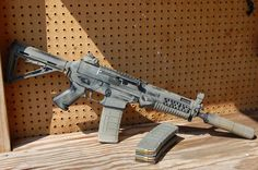 Sig Sauer 552 suppressed SBR Loading that magazine is a pain! Get your Magazine speedloader today! http://www.amazon.com/shops/raeind