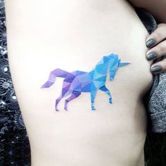 Polygon style unicorn tattoo on the right side ribcage. Tattoo...