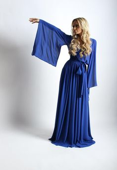 Luxurious electric blue evening maxi dress with a belt and side pockets. The neckline is decorated with a metal braid and crystals.  Item length from the waist: 125 см. Any size of the garment can be made per your measurements.  Material: Crepe-chiffon.