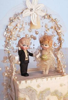 I have an entire collection of vintage cake toppers....this one is absolutely precious!