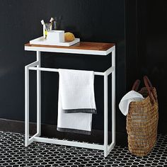 like the idea of this little free standing towel rack + small counter space. hmm...