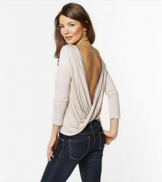 Hue la la! Dare to reveal your sexy back with this wrapped back top! Layer it with one of our lace bandeaus.