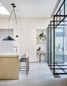 Contemporary kitchen design with steel doors stained cabinets and modern lighting Home Decor Styles, Cheap Home Decor, Home Decor Accessories, French Home Decor, Vintage Home Decor, Living Room Remodel, Living Room Decor, Layout Design, Cheap Bathrooms