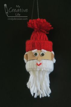 Yarn Santa Ornament 2019 Remember yesterday's yarn hat ornaments from Yarn Whimsies for the Holidays (affiliate link)? With just a few more steps you can turn a The post Yarn Santa Ornament 2019 appeared first on Yarn ideas. Easy Yarn Crafts, Yarn Crafts For Kids, Arts And Crafts For Teens, Art And Craft Videos, Family Crafts, Santa Ornaments, Ornament Crafts, Diy Christmas Ornaments, How To Make Ornaments