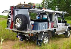 Imagine this Tray style camper / canopy on a trailer, the big gull wing doors would make great awnings.