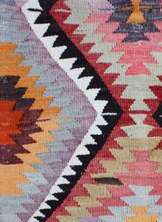 I like the repetition of the triangular patterns and how well the colours fit together