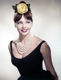 Leslie Caron, In Guns Of Darkness, 1962 Photograph in the quintessential little black dress with yellow rose fascinator and quadruple rows of beads