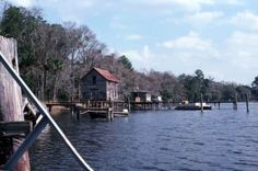 View showing docks by the St. John's River near Crescent City, Florida. 1982.