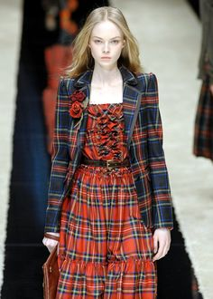 I'm still not sure why models have to look just this side of death (and crabby about it), but the tartan is great. Tartan Fashion, Love Fashion, Autumn Fashion, Fashion Design, Style Fashion, Scottish Plaid, Scottish Tartans, Tartan Dress, Tartan Plaid