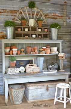 Pretty potting bench in a gardening shed with galvanized tin on the walls in between the studs