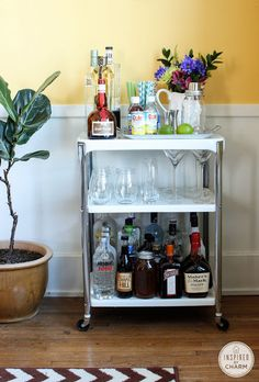 Inspired by Charm: Bar Cart Styling -- love the white pitcher for flowers and the champ flutes