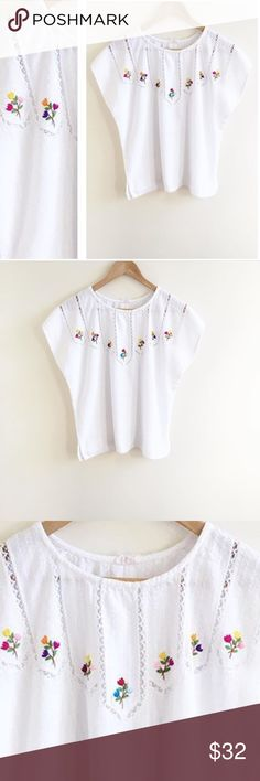 El Guipil. Will might fit M the best, tag says L El Guipil. Will might fit M the best, but tag says L. Made in El Salvador 🇸🇻 little tiny embroidered flowers and eyelets. White with many colors on pure white shirt sleeve top. Likely 100% cotton but it doesn't say. Tops Blouses